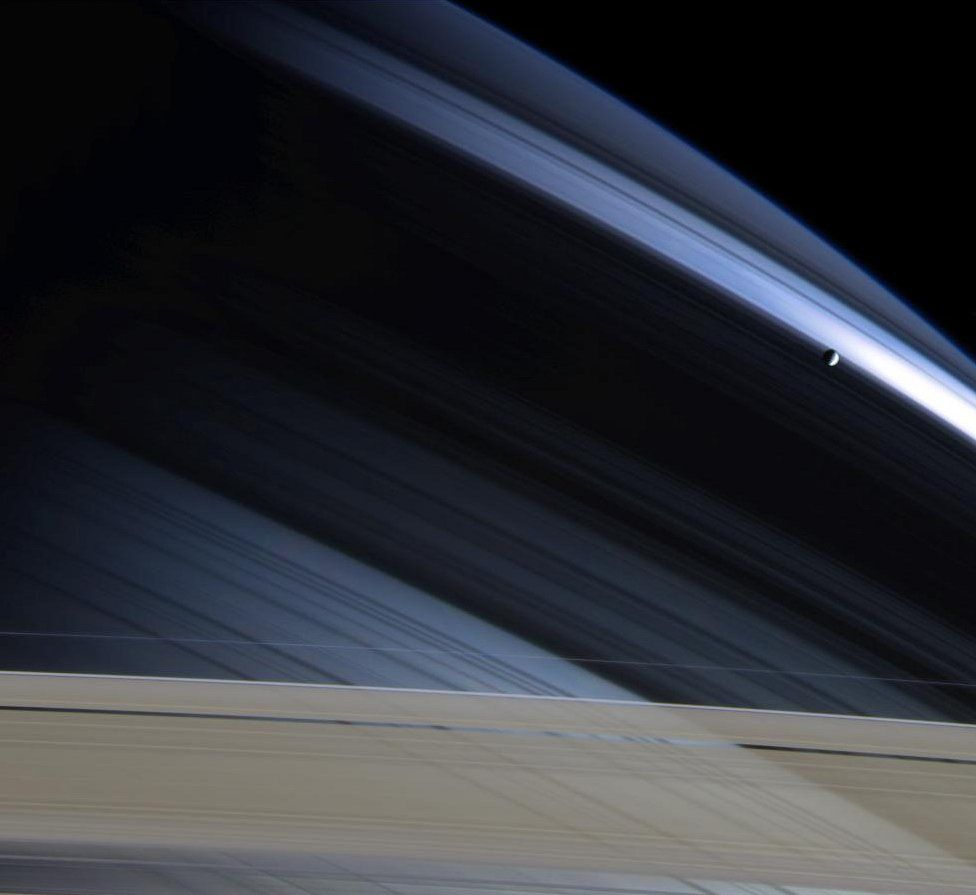 Mimas against Saturn's northern hemisphere