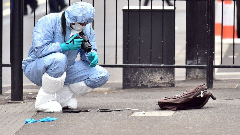 Police photographer in Whitehall
