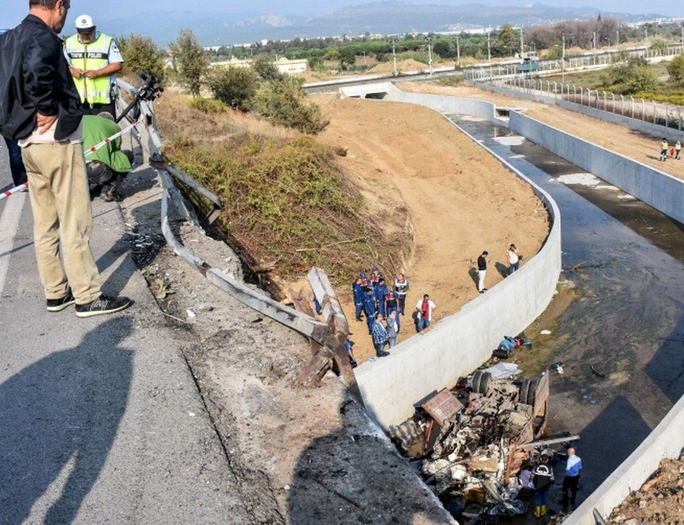 The lorry crashed through a barrier and plunged 20m