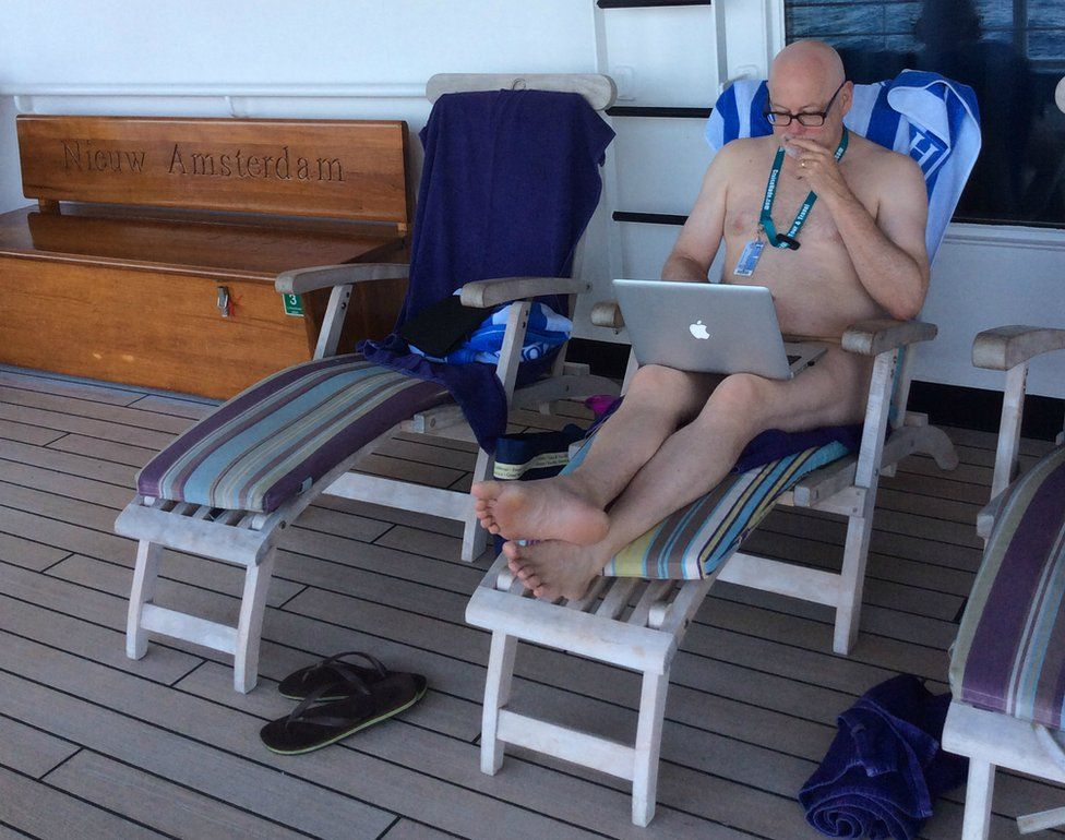 Mark Haskell Smith working on his laptop on a cruise ship