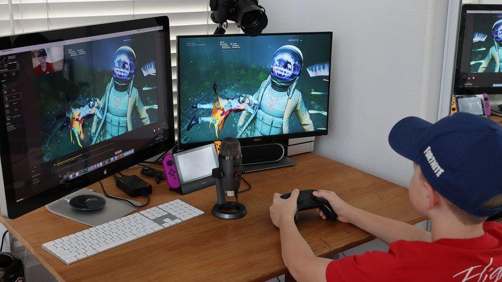 A teenager plays and streams Fortnite ona streaming setup