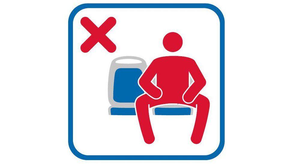 Sign discouraging manspreading by Empresa Municipal de Transportes de Madrid