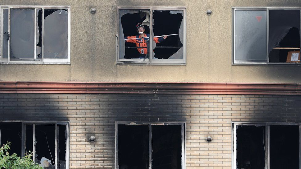 A firefighter inspects the interior of the torched Kyoto Animation building in Kyoto