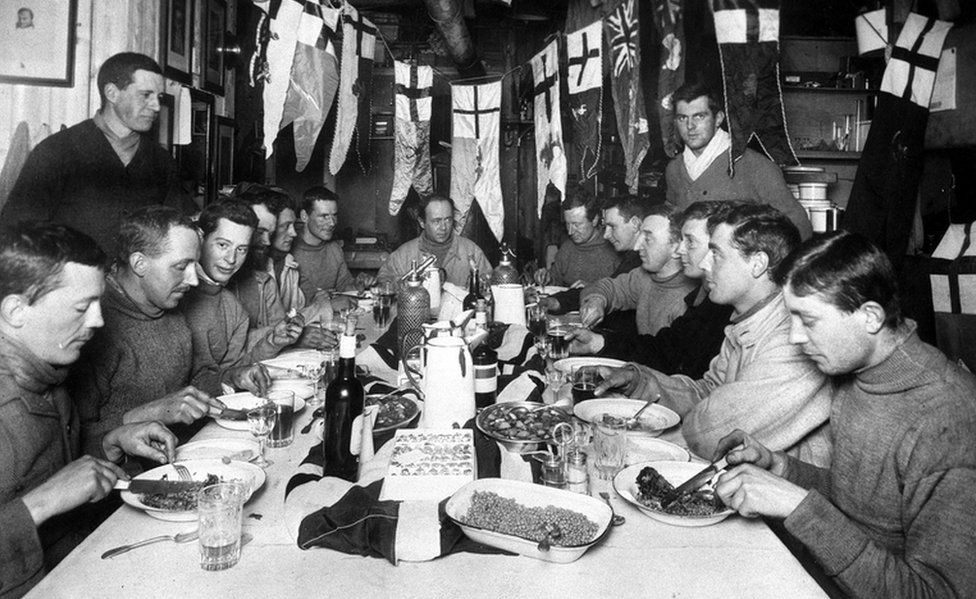 Captain Robert Scott (seated centre, back) and members of his ill-fated expedition to Antarctica enjoying his last birthday party.
