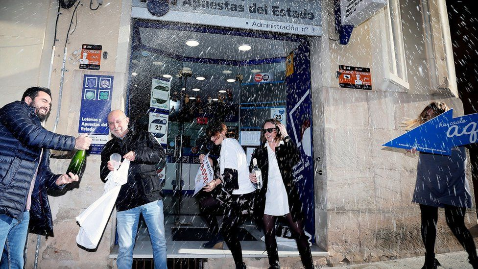 People celebrate at the lottery administration number 3 in Alcoy, Alicante.