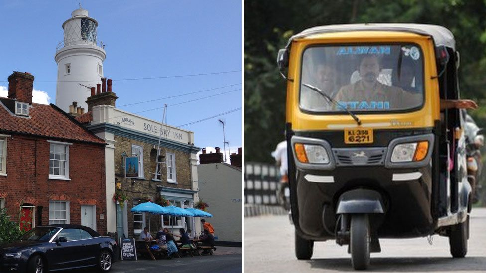 Southwold lighthouse and Sole Bay Inn with a tuk tuk