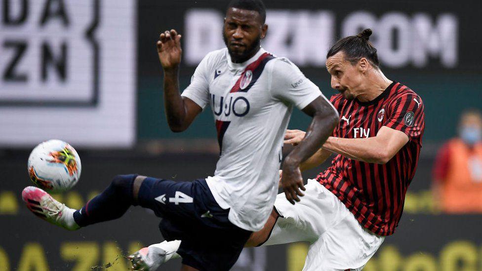 AC Milan's Zlatan Ibrahimovic kicks the ball against Bologna