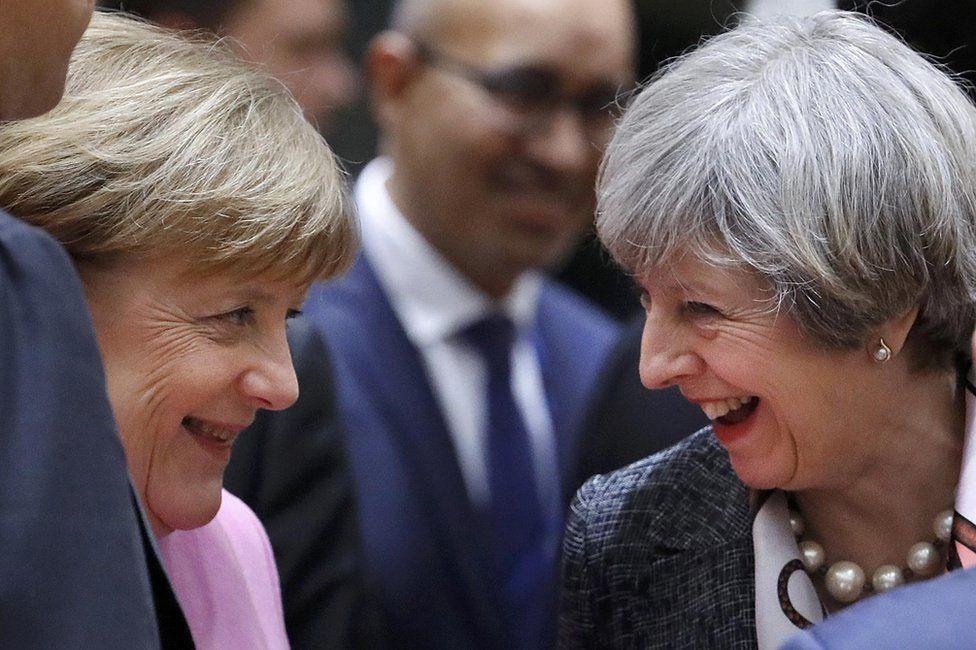 Angela Merkel (l) and Theresa May