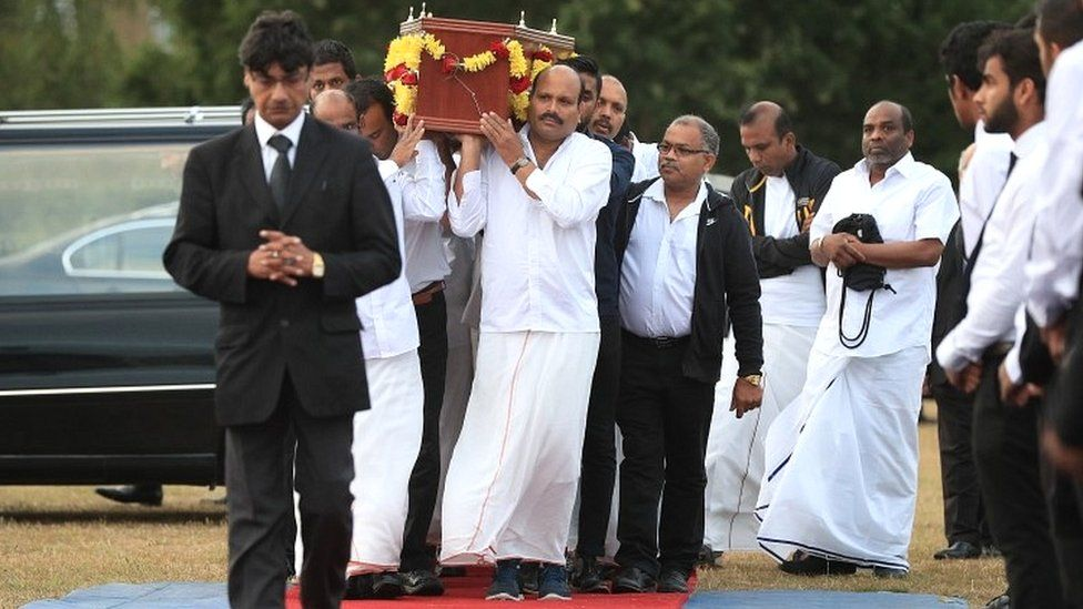 The coffin of Gurushanth Srithavarajah is carried to into marquee tents on Winn's Common