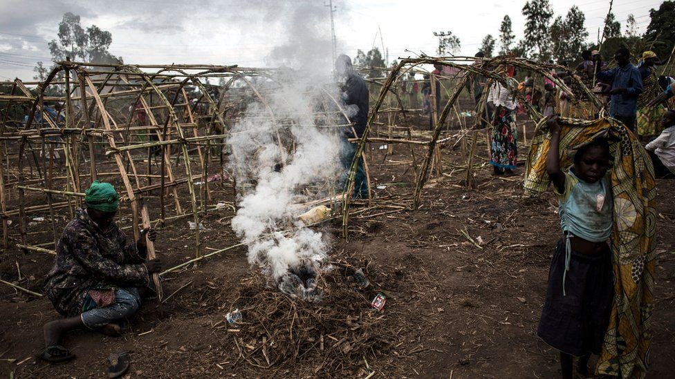 Internally Displaced Congolese construct makeshift shelters in a camp for displaced people on 27 February 2018 in Bunia.