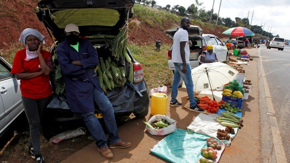 Motorists wait for customers next to their vehicles, used as alternative mobile grocery stalls along the highway, following a lockdown due to the coronavirus disease (COVID-19) outbreak, on the outskirts of Nairobi, Kenya May 25, 2020