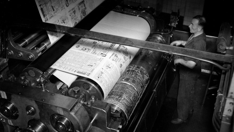 A man watches over the printing of the day's newspaper in August 1935 at the Daily Express press building, Fleet Street.