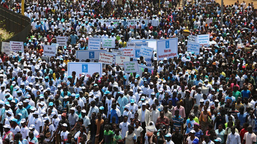Supporters of President Faure Gnassingbe take part in a march in support of him in Lome, Togo, September 20, 2017