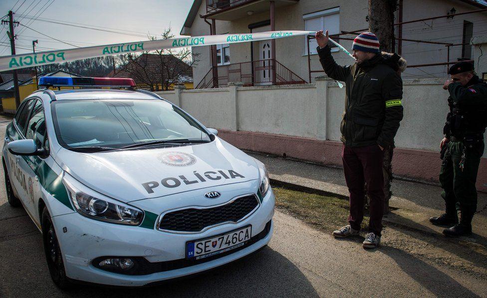 Slovak police car at crime scene, 26 Feb 18