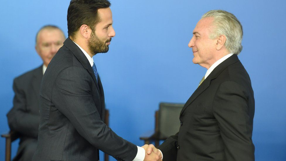 Acting Brazilian President Michel Temer (R) greets the new minister of culture, Marcelo Calero, during his swearing-in ceremony at the Planalto Palace, the seat of government in Brasilia, on May 24, 2016.