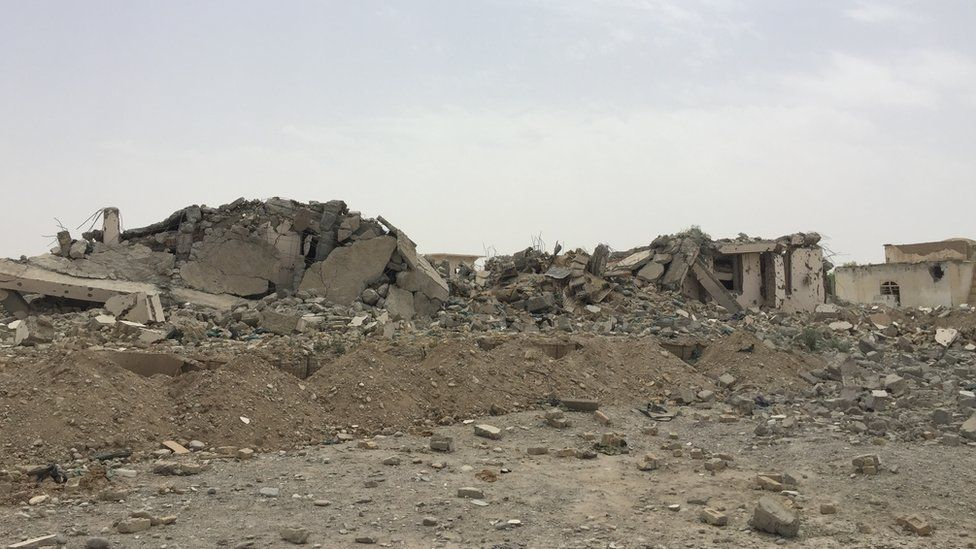 Bomb damage at the police station in Sangin