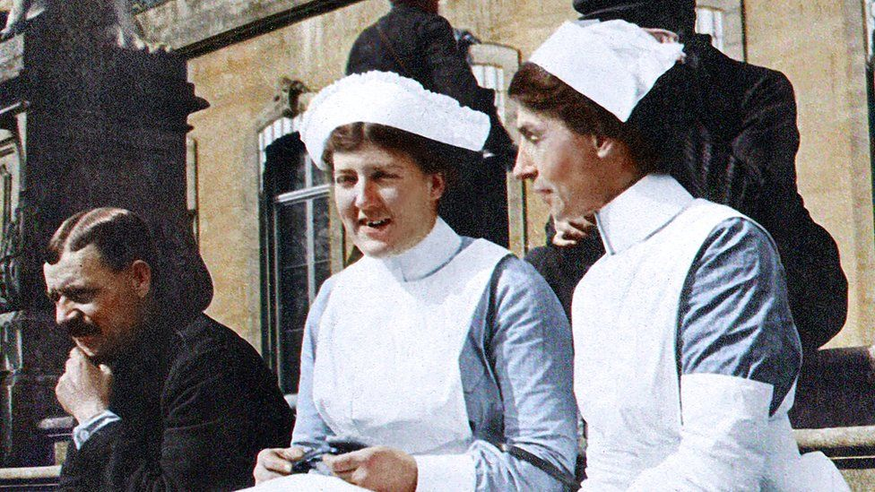 Two nurses on a step