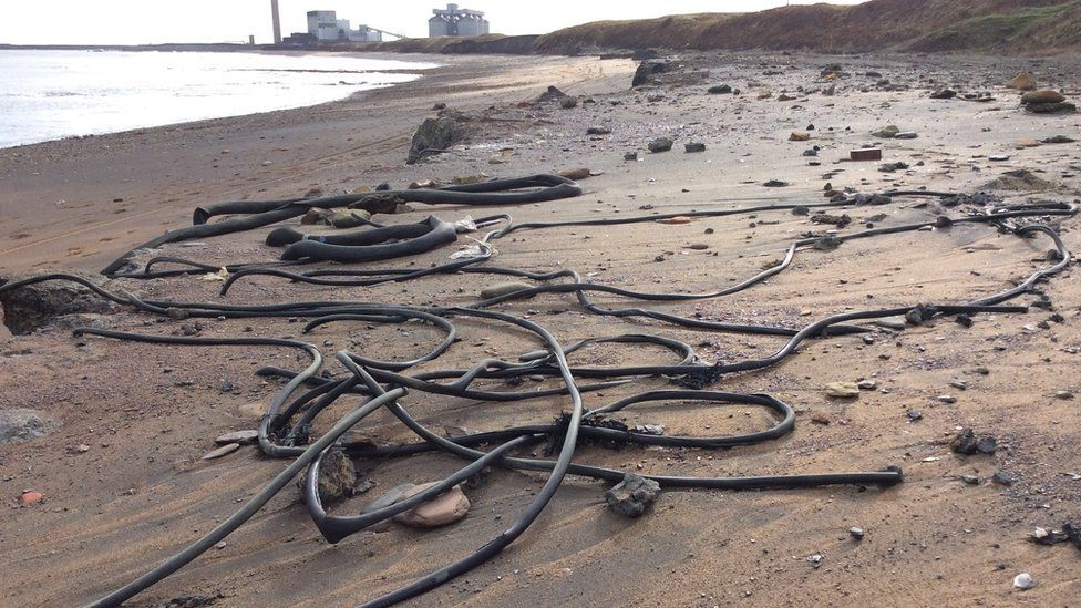 Pipes and cables on the sand at Lynemouth Beach