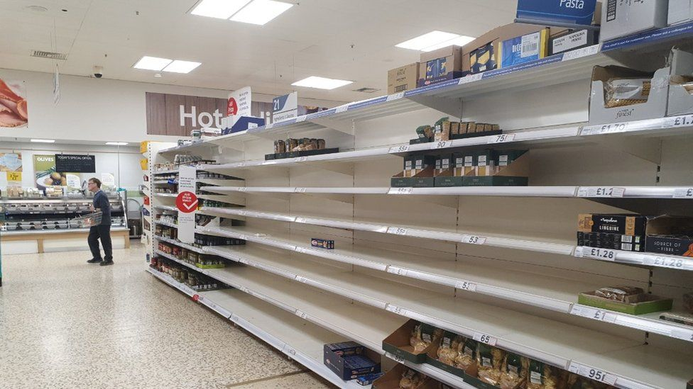 Empty pasta shelves at the Tesco store in Royston, Hertfordshire