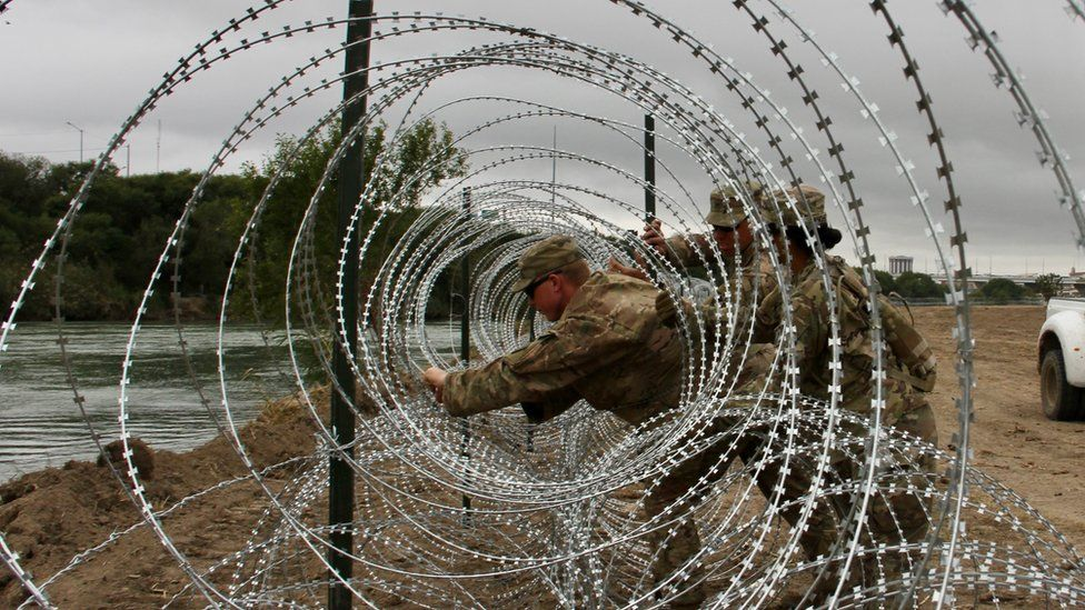 Soldiers from the Kentucky-based 19th Engineer Battalion install barbed and concertina-wire in Laredo, Texas, on November 17, 2018