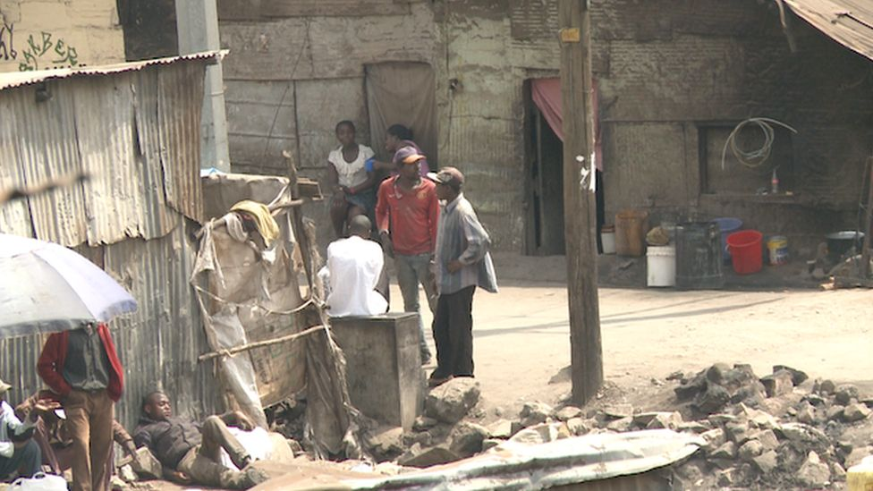 Young men gather in Mathare slum