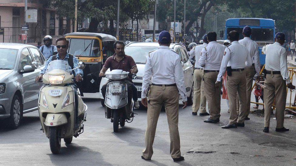 Police in Pune checking motorbike riders