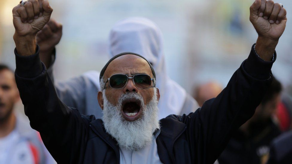 Bahraini protester shouts anti-government slogans during a march in Daih, Bahrain