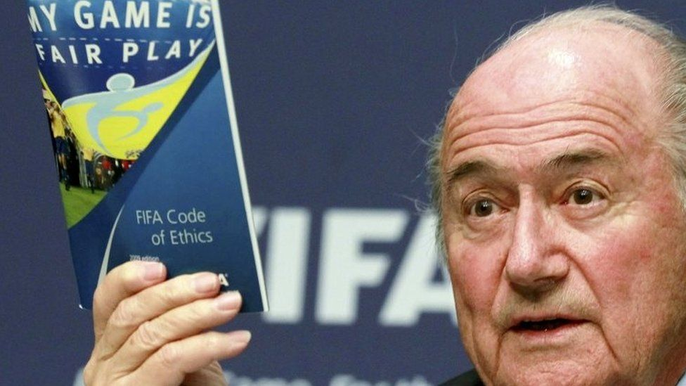 Fifa President Sepp Blatter displays a brochure containing the Fifa code of ethics as he addresses a news conference at the Fifa headquarters in Zurich, Switzerland (30 May 2011)