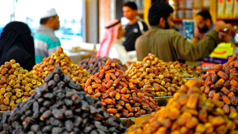 Saudi's buy dates at a shop in Jeddah ahead of the Muslim holy fasting month of Ramadan on May 24, 2017.