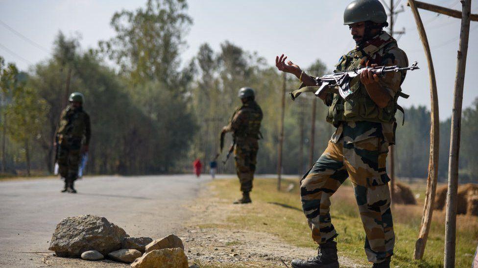 Indian army-men stand alert near gunfight site in Bejhbehara, South Kashmir some 60 kms from summer capital Srinagar.