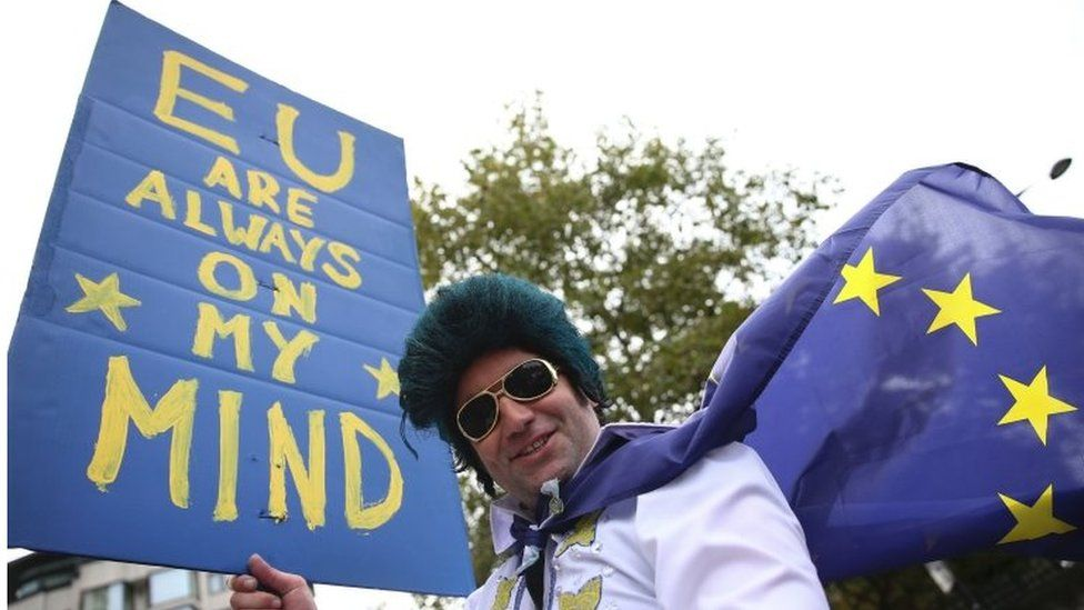 A man dressed as Elvis Presley stands with a pro-Europe placard as people gathered for a March for Europe