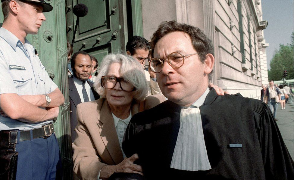 A file picture taken on September 16, 1992 shows Fernande Grudet also known as Madame Claude leaving the Court in Paris during her trial.
