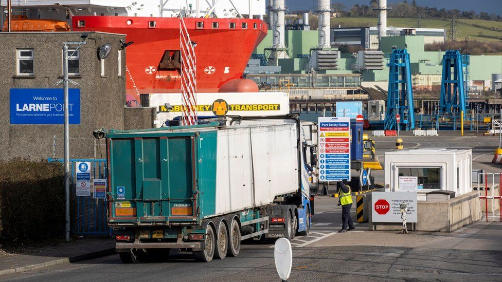 Security staff at Larne Port speak with a lorry driver (archive photo from March 2021)