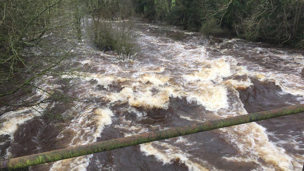 Fast-flowing water in Kellswater in County Antrim