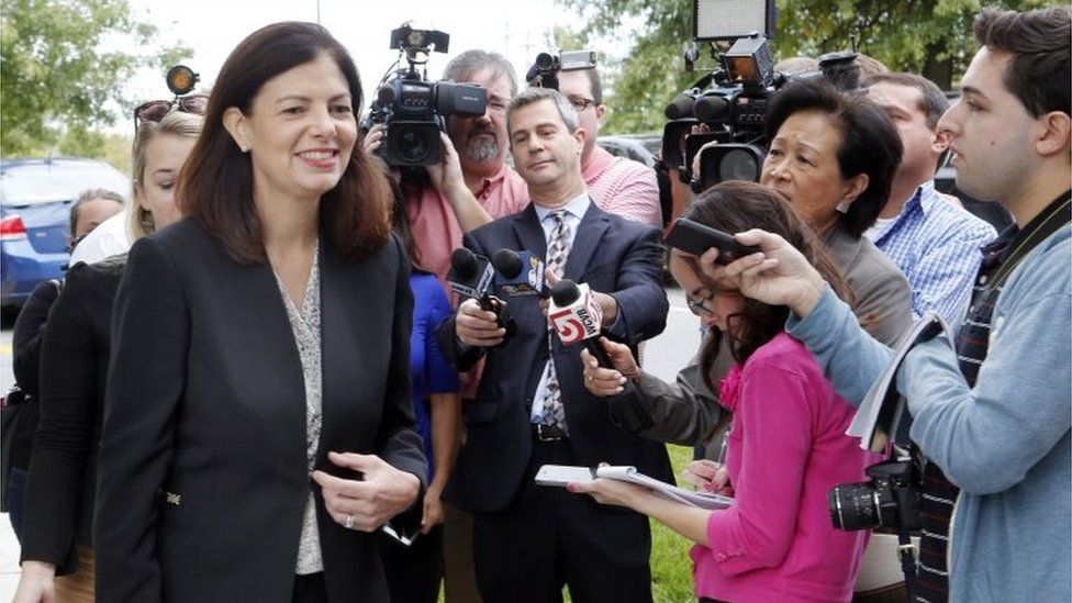 Senator Kelly Ayotte walks away from reporters Tuesday Oct. 4, 2016 in Hudson, New Hampshire