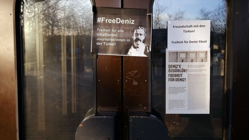 A sign for the arrested journalist Deniz Yuecel
