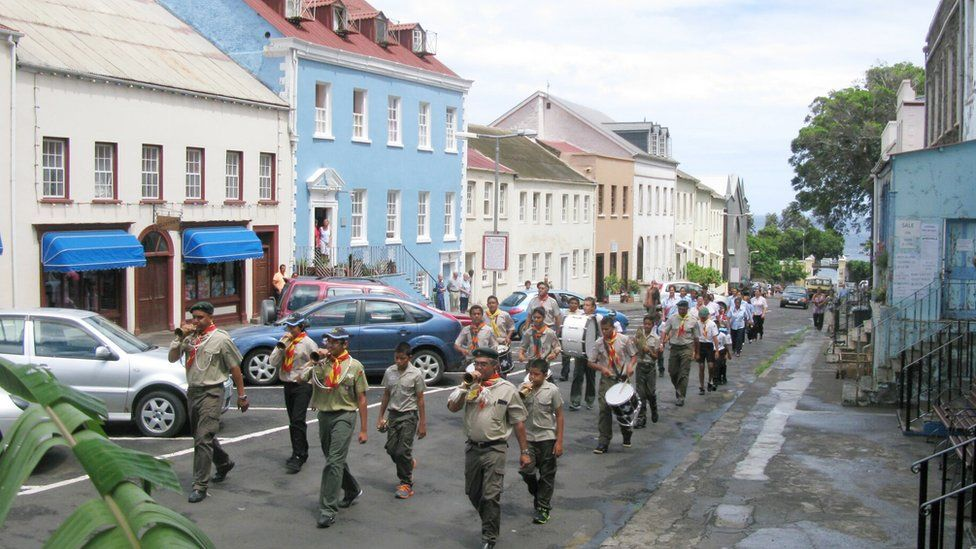 Band marches along main street in St Helena