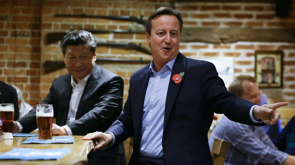 China's President Xi Jinping and Britain's Prime Minister David Cameron drink a pint of beer during a visit to the The Plough pub on October 22, 2015 in Princes Risborough, England.