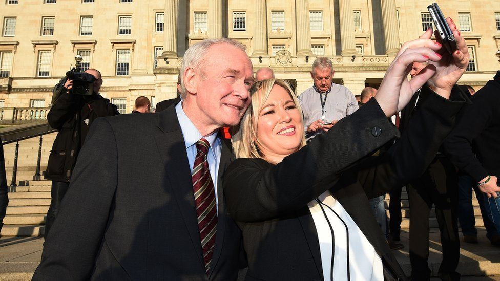 Sinn Fein's Stormont leader Michelle O'Neill takes a selfie with the late Martin McGuinness on the steps of Stormont in January 2017