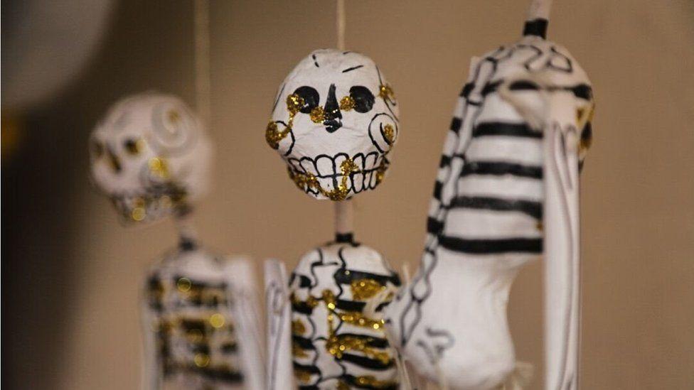 A close-up of papier mache skeletons