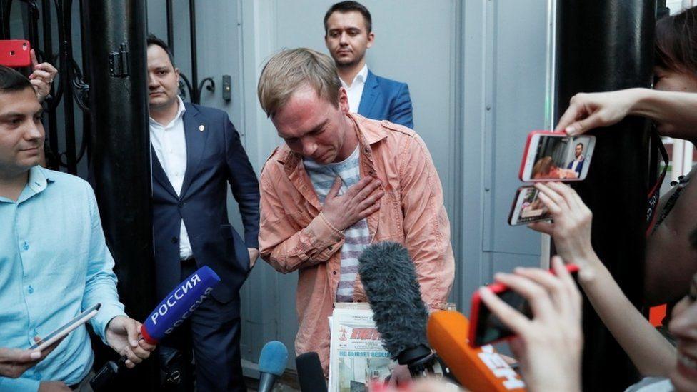 Russian journalist Golunov walks out of the city office of criminal investigations in Moscow