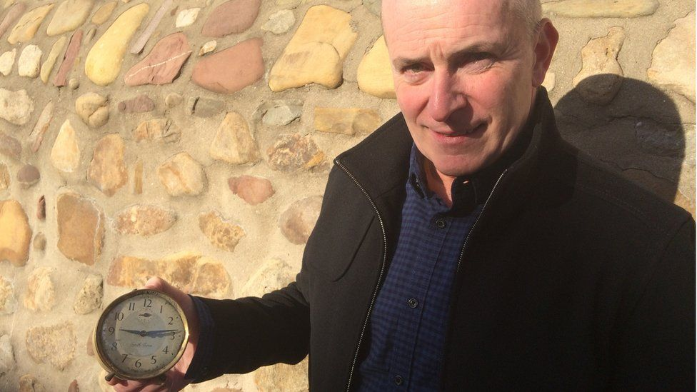 Mike Flynn with a clock his father - one of the rescuers at Aberfan - dug up.