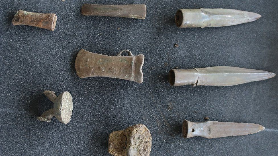 Hoard of spears, and a gouge, chisel and an axe and some metalworking waste