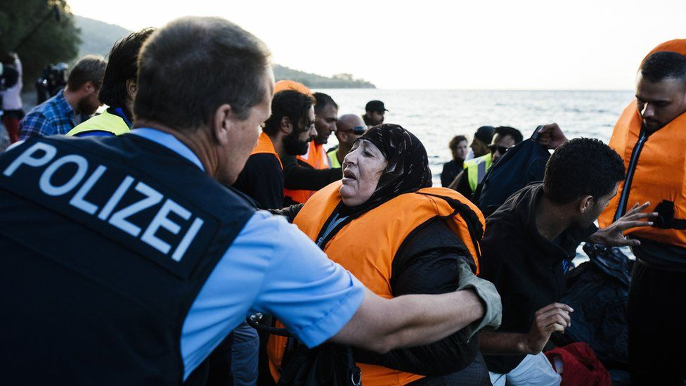 German police helping refugees in Lesbos, Greece, 17 Oct 15