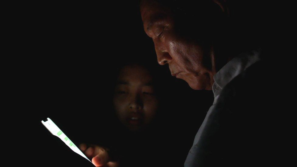 Pastor Chun Kiwon receives a text to confirm Mira and Jiyun are safely over the Chinese border
