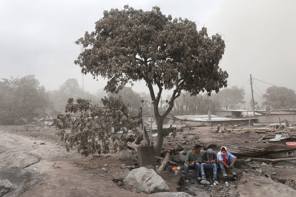 Residents rest during a search at an area affected by the eruption of Fuego volcano in San Miguel Los Lotes in Escuintla, Guatemala, June 7, 2018