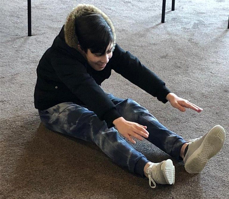 Mehdi stretching for his toes at the Sunday education support group
