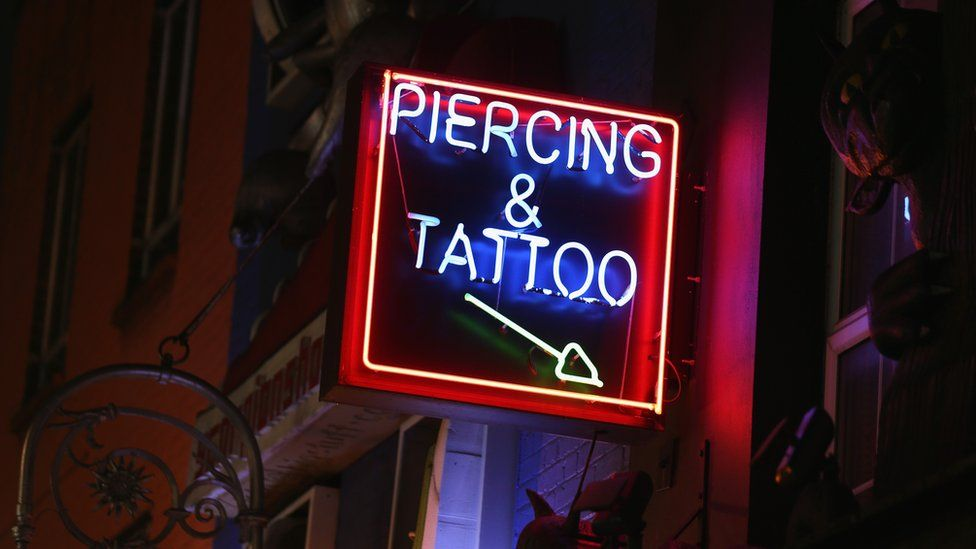Tattoo and piercing parlour sign