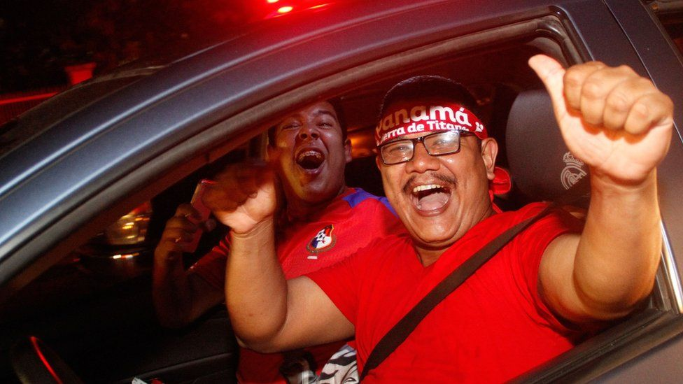 Two Panama fans celebrate their country's World Cup qualification