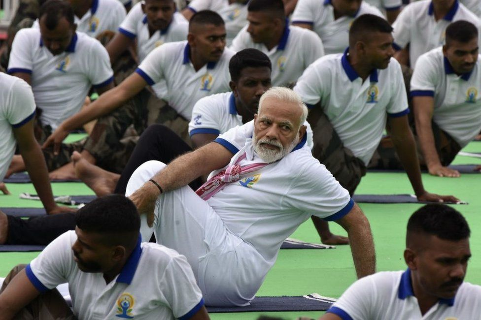 Indian Prime Minister Narendra Modi performs yoga during a mass yoga event on International Yoga Day in Ranchi in eastern Jharkhand state June 21, 2019.